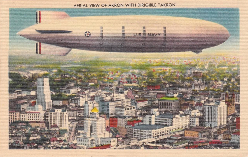 Aerial View of Akron with dirigible ""